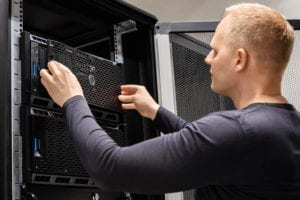 male technician installing server